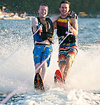 Brothers, Adam and Jonathan Chodzko water ski. Adam on a 25 year old Connelly wooden ski and Jonathan on a new fiberglass Connelly ski.