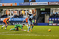 Garry Thompson of Wycombe Wanderers rounds Mark Tyler of Luton Town (2nd left) to score the opening goal against Luton Town during the Sky Bet League 2 match between Luton Town and Wycombe Wanderers at Kenilworth Road, Luton, England on 26 December 2015. Photo by David Horn.