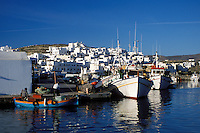 Paros, Naoussa, Greece, Greek Islands, Cyclades, Europe, Fishing boats docked in Naoussa Harbor on Paros Island on the Aegean Sea.