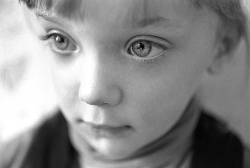Little girl eyes. Closeup of little girl face. B&W little girl face.