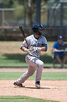 AZL Padres 2 catcher Luis Roman (4) follows through on his swing during an Arizona League game against the AZL Dodgers at Camelback Ranch on July 4, 2018 in Glendale, Arizona. The AZL Dodgers defeated the AZL Padres 2 9-8. (Zachary Lucy/Four Seam Images)