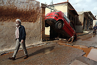 Pictured: A car is wedged between two walls.<br /> Re: Five people have reportedly died and severe damage caused by heavy rain and flash flooding in the area of Mandra, near Athens, Greece. Wednesday 15 November 2017