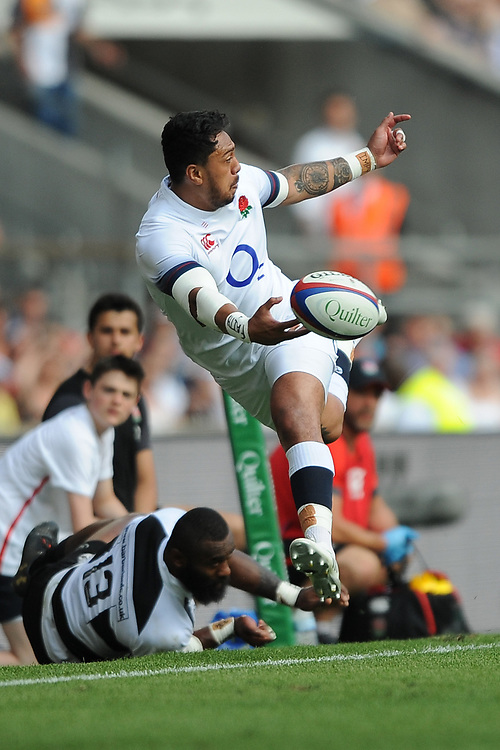 Denny Solomona of England keeps the ball in play during the Quilter Cup match between England and Barbarians at Twickenham Stadium on Sunday 27th May 2018 (Photo by Rob Munro/Stewart Communications)