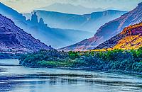 Smoky sunrise along the Colorado River,  Fisher Towers, La Sal Mountains, near Moab, Utah BLM lands