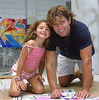 """Miami Beach, FL 1-20-2002<br /> Anthony Shriver, (Maria's brother)<br /> with daughter Francesca painting at Romero Britto's impromptu """"Paint Party"""", an afternoon <br /> of painting for friends and their families, <br /> Photo by Adam Scull/PHOTOlink"""