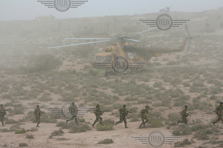 Revolutionary Guard special forces participate in military manoeuvers at an undisclosed location.