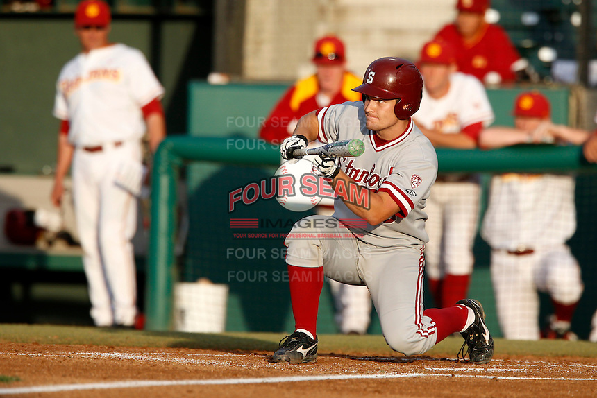 Brant Whiting #6 of the Stanford Cardinal looks to lay down a bunt during a game against the USC Trojans at Dedeaux Field on April 5, 2013 in Los Angeles, California. (Larry Goren/Four Seam Images)