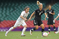 Katie HOYLE of New Zealand shields the ball from Karen CARNEY of Great Britain - Great Britain Women vs New Zealand Women - Womens Olympic Football Tournament London 2012 Group E at the Millenium Stadium, Cardiff, Wales - 25/07/12 - MANDATORY CREDIT: Gavin Ellis/SHEKICKS/TGSPHOTO - Self billing applies where appropriate - 0845 094 6026 - contact@tgsphoto.co.uk - NO UNPAID USE.