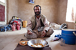 5 June 2013, Kholm District,  Mazar-i-Sharif, Balkh Province, Afghanistan.  A man eats his lunch at a small roadside stall that sells soft drinks in Kholm District, Mazar-i-Sharif,    Picture by Graham Crouch/World Bank.