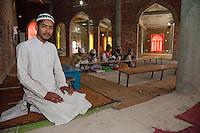 Madrasa Students with their Imam, inside Mosque under Construction.  Madrasa Islamia Arabia Izharul-Uloom, Dehradun, India.