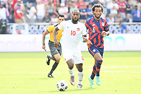 KANSAS CITY, KS - JULY 18: Junior Hoilett #10 of Canada during a game between Canada and USMNT at Children's Mercy Park on July 18, 2021 in Kansas City, Kansas.