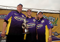 May 1, 2011; Baytown, TX, USA: NHRA pro stock driver Vincent Nobile (center)celebrates with father John Nobile (right) after winning the Spring Nationals at Royal Purple Raceway. Mandatory Credit: Mark J. Rebilas-