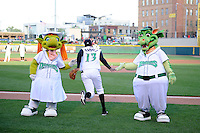 Dayton Dragons mascots greet Robert Ramirez #13 on his way to the field before a game against the Bowling Green Hot Rods on April 20, 2013 at Fifth Third Field in Dayton, Ohio.  Dayton defeated Bowling Green 6-3.  (Mike Janes/Four Seam Images)