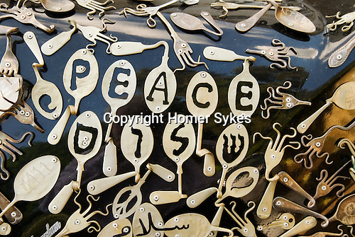 Uri Geller at home Berkshire England 2008. Detail of his bent spoon Peace car. 1976 Cadillac  encrusted with over 5,000 pieces of contorted and bend spoons and cutlery.