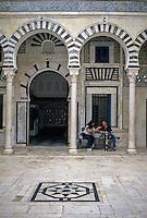 Tunisia.  Tunis Medina.  Dar Hamouda Pacha, late 18th. Century.  Now a restaurant and tea house.  Couple Enjoying Conversation and a Sheesha.  Casual Western Dress.