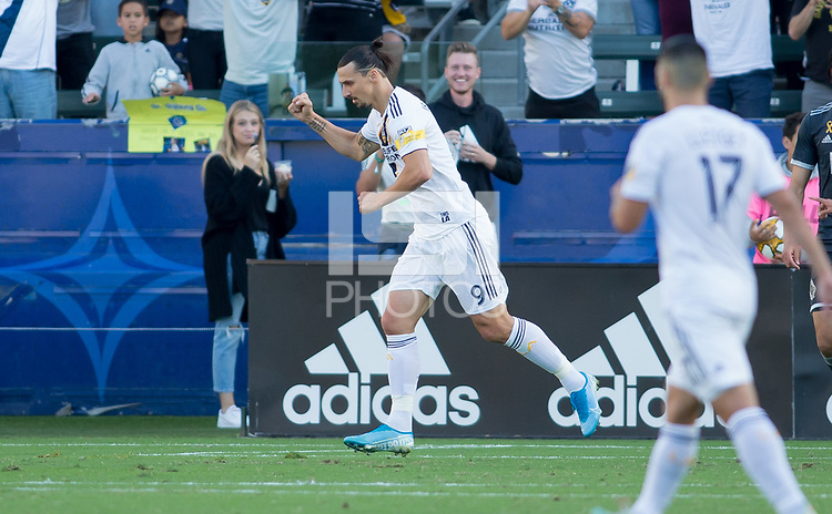 CARSON, CA - SEPTEMBER 29: Zlatan Ibrahimovic #9 of the Los Angeles Galaxy scores and celebrates with teammates during a game between Vancouver Whitecaps and Los Angeles Galaxy at Dignity Health Sports Park on September 29, 2019 in Carson, California.