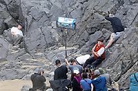 Pictured: Conieth Hill. Friday 18 June 2021<br /> Re: Film set with a scene being filmed with Hugh Laurie as a director at Three Cliffs Bay in the Gower Peninsula, Wales, UK.