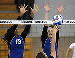 Marymount University's Jennifer Forbes, left, and Emily Shultis go up for a block during college volleyball action at Goucher College in Towson, MD, on Saturday, Oct. 8, 2011..Photo by Cathleen Aliison