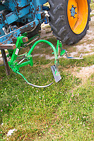 A vineyard tractor equipped with knifes to mechanically cut off remove grass and weed to minimise the need for weed killer spraying at the experimental vineyard of the CIVC at Plumecoq near Chouilly in the Cote des Blancs It is used for testing clones soil treatment vine treatments spraying, Champagne, Marne, Ardennes, France