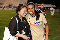 Marta (10) of FC Gold Pride poses for a photo with a fan. FC Gold Pride defeated Sky Blue FC 1-0 during a Women's Professional Soccer (WPS) match at Yurcak Field in Piscataway, NJ, on May 1, 2010.