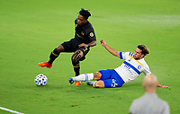LOS ANGELES, CA - SEPTEMBER 02: Cade Cowell #44 of the San Jose Earthquakes slide tackles Latif Blessing #7 of LAFC while LAFC head coach Bob Bradley looks on during a game between San Jose Earthquakes and Los Angeles FC at Banc of California stadium on September 02, 2020 in Los Angeles, California.