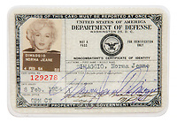 BNPS.co.uk (01202 558833)<br /> Pic: Julien'sAuctions/BNPS<br /> <br /> PICTURED: Marilyn Monroe's 'Non Combatant's Certificate of Identity' card lists by her real name 'Norma Jeane DiMaggio'<br /> <br /> Marilyn Monroe's personalised army jacket and ID card have emerged for sale for £80,000. ($100,000)<br /> <br /> The starlet wore the green woollen jacket which is covered in army patches during her famous visit to entertain US troops in Korea in February 1954.<br /> <br /> The name 'Monroe' is in white stitching above the left pocket, and there are black and white photos of her posing in the long sleeved 'medium' sized jacket.<br />  <br /> Monroe has signed it and a wealth of personal information is listed, including her date of birth, height, weight, hair colour and blood type. The items are being sold with Los Angeles based Julien's Auctions.