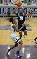 Bentonville West's Anthony George (23) takes a shot in the lane Tuesday, Jan. 5, 2021, as he is guarded by Fayetteville's CJ Williams (left) during the first half of play in Bulldog Arena in Fayetteville. Visit nwaonline.com/210106Daily/ for today's photo gallery. <br /> (NWA Democrat-Gazette/Andy Shupe)