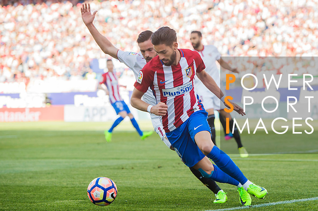 Yannick Ferreira Carrasco (r) of Atletico de Madrid fights for the ball with Pablo Sarabia Garcia of Sevilla FC during their La Liga match between Atletico de Madrid and Sevilla FC at the Estadio Vicente Calderon on 19 March 2017 in Madrid, Spain. Photo by Diego Gonzalez Souto / Power Sport Images