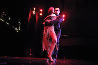 Dancers tango on stage at Esquina Carlos Gardel, a restaurant who offers dinners with tango shows, at the Abasto Market, in Buenos Aires, April 26, 2003. Photo by Quique Kierszenbaum.