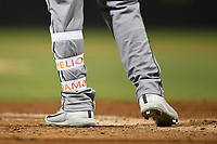 Center fielder Heliot Ramos (14) of the Augusta GreenJackets wears his name on his shin guard straps in a game against the Columbia Fireflies on Friday, April 6, 2018, at Spirit Communications Park in Columbia, South Carolina. Columbia won, 7-2. (Tom Priddy/Four Seam Images)