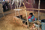 A woman extending her temporary shelter near Nagapattinam.India.