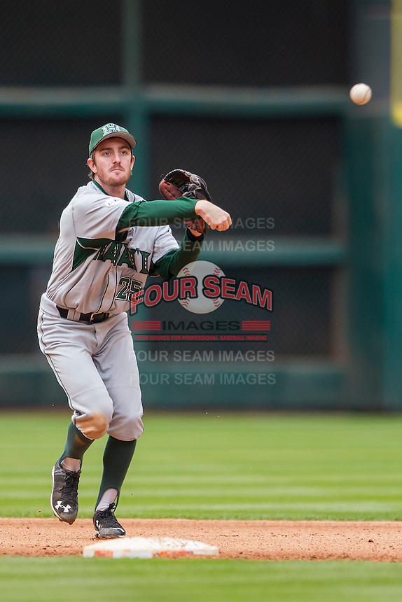 Hawaii Rainbow Warriors shortstop Jacob Sheldon-Collins (25) makes a throw to first base during the NCAA baseball game against the Nebraska Cornhuskers on March 7, 2015 at the Houston College Classic held at Minute Maid Park in Houston, Texas. Nebraska defeated Hawaii 4-3. (Andrew Woolley/Four Seam Images)