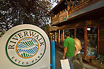 Riverwalk sign in front of Macdonald Bookshop at Elkhorn Avenue on a summer evening in downtown Estes Park, Colorado, Rocky Mountains