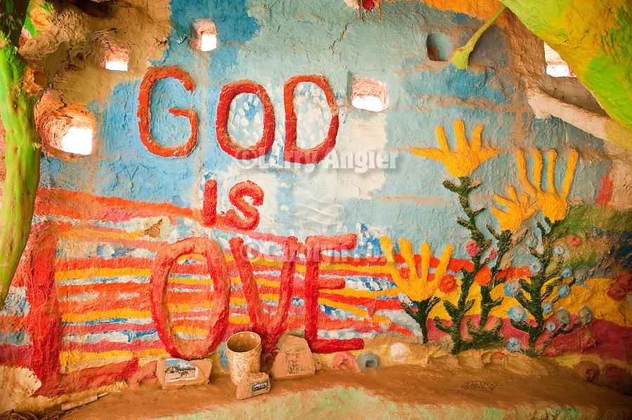 Inside the museum of Leonard Knight's Salvation Mountain, near Niland, Calif. God is Love.