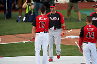 Los Angeles Angels Albert Pujols shakes hands with Chicago Cubs Kris Bryant during introductions before the MLB Home Run Derby on July 13, 2015 at Great American Ball Park in Cincinnati, Ohio.  (Mike Janes/Four Seam Images)