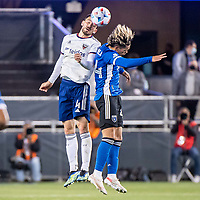 SAN JOSE, CA - MAY 01: Brendan Hines-Ike #4 of DC United goes up for a header with Cade Cowell #44 of the San Jose Earthquakes during a game between San Jose Earthquakes and D.C. United at PayPal Park on May 01, 2021 in San Jose, California.