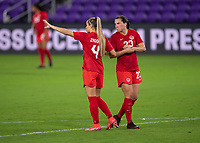 ORLANDO CITY, FL - FEBRUARY 18: Shelina Zadorsky #4 gives instruction to Vanessa Gilles #23 during a game between Canada and USWNT at Exploria stadium on February 18, 2021 in Orlando City, Florida.