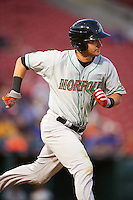 Norfolk Tides shortstop Paul Janish (11) runs to first base during a game against the Buffalo Bisons on July 18, 2016 at Coca-Cola Field in Buffalo, New York.  Norfolk defeated Buffalo 11-8.  (Mike Janes/Four Seam Images)