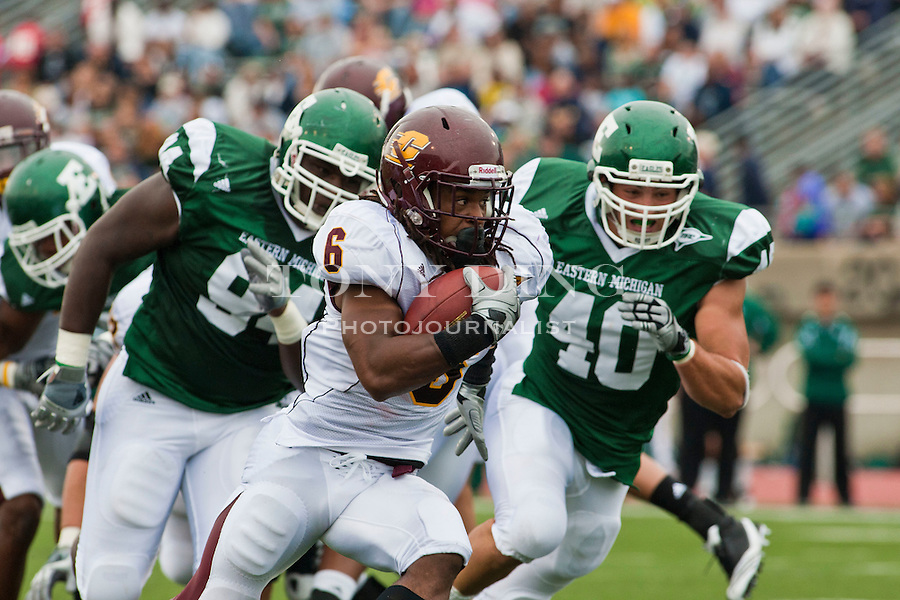 Eastern Michigan defensive tackle Jabar Westerman (94) and linebacker Neal Howey (40) pursue Central Michigan running back Paris Cotton (6) in the first quarter of an NCAA college football game, Saturday, Sept. 18, 2010, in Ypsilanti, Mich. (AP Photo/Tony Ding)