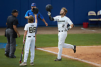 Johnny Aiello (2) of the Wake Forest Demon Deacons is greeted by bat boy Eddie Papsun after hitting a home run against the Florida Gators in Game Two of the Gainesville Super Regional of the 2017 College World Series at Alfred McKethan Stadium at Perry Field on June 11, 2017 in Gainesville, Florida.  (Brian Westerholt/Four Seam Images)