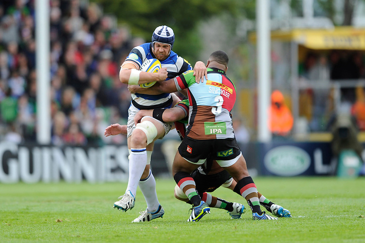 Dave Attwood of Bath Rugby is tackled by Kyle Sinckler of Harlequins during the Aviva Premiership match between Harlequins and Bath Rugby at The Twickenham Stoop on Saturday 10th May 2014 (Photo by Rob Munro)