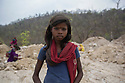 "India - Jharkhand - Doda Cola - Ten-year-old Fulmati Kumari works in the scenic mine of Doda Cola, a huge grey crater lost amid the tropical forests near Domchanch. Originally from the village of Jampur, this young girl comes here with her parents everyday, working from 9.30am to 4pm. ""I don't like this job, it is very tough, but what can I do?"" she says. ""At least I can earn some money and help my family"". A former 5th-standard-student, Fulmati dropped-out of school to help her family, a decision she regrets but cannot overturn. ""I would like to go to school instead of being here, but I can't"", she says."