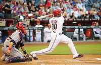 May 8, 2009; Phoenix, AZ, USA; Arizona Diamondbacks outfielder Justin Upton hits an RBI sacrifice out in the first inning against the Washington Nationals at Chase Field. Mandatory Credit: Mark J. Rebilas-