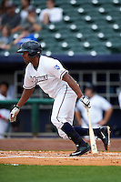 NW Arkansas Naturals outfielder Jorge Bonifacio (24) at bat during a game against the San Antonio Missions on May 31, 2015 at Arvest Ballpark in Springdale, Arkansas.  NW Arkansas defeated San Antonio 3-1.  (Mike Janes/Four Seam Images)
