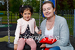 Enjoying the swings in the Listowel town park on Saturday, l to r: Maci Gleeson with her mom Mary Flynn.