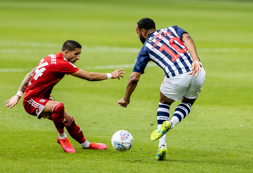 Fulham's Anthony Knockaert is beaten by a back heel flick   from West Bromwich Albion's Matt Phillips (right) <br /> <br /> Photographer Andrew Kearns/CameraSport<br /> <br /> The EFL Sky Bet Championship - West Bromwich Albion v Fulham - Tuesday July 14th 2020 - The Hawthorns - West Bromwich <br /> <br /> World Copyright © 2020 CameraSport. All rights reserved. 43 Linden Ave. Countesthorpe. Leicester. England. LE8 5PG - Tel: +44 (0) 116 277 4147 - admin@camerasport.com - www.camerasport.com