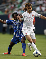 Kyle Beckerman (5) is pressured by Walter Martinez (15).  The US Men's National Team defeated Honduras 2-0 in the semifinals of the Gold Cup at Soldier Field in Chicago, IL on July 23, 2009.