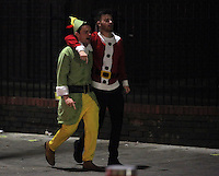 Pictured: Two men wearing Christmas themed costumes in the early hours of Saturday, 17 December, 2016<br />