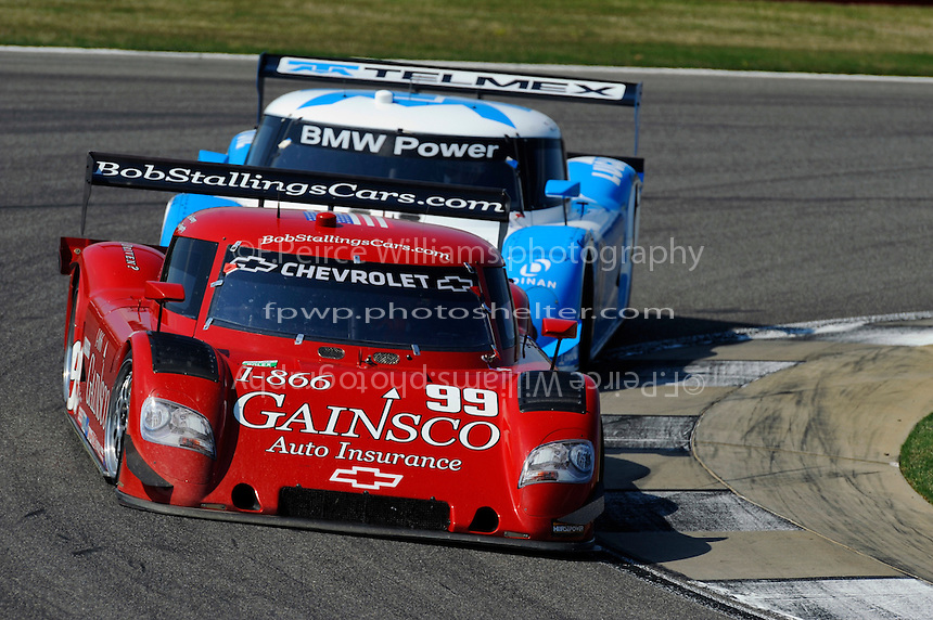 #99 Gainsco/Bob Stallings Racing Chevrolet/Riley of Jon Fogarty & Alex Gurney and the #01 Chip Ganassi Racing with Felix Sabates BMW/Riley of Scott Pruett & Memo Rojas