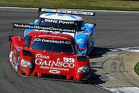 #99 Gainsco/Bob Stallings Racing Chevrolet/Riley of Jon Fogarty & Alex Gurney and the #01 Chip Ganassi Racing with Felix Sabates BMW/Riley of Scott Pruett & Memo Rojas